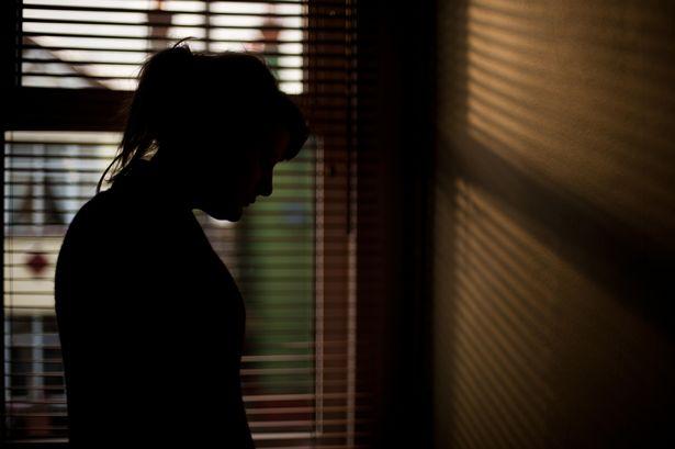 Silhouette-of-woman-by-window